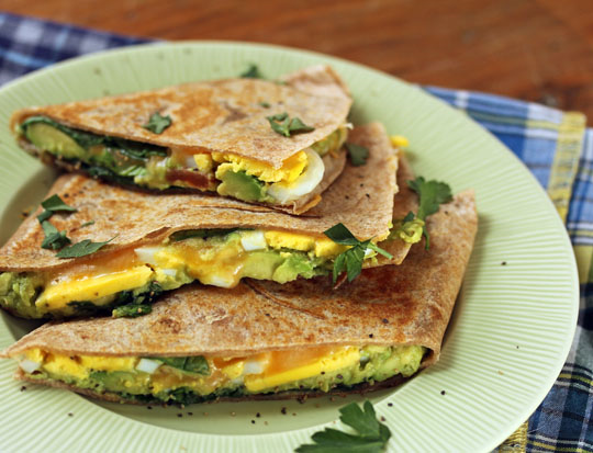 Start your day with these avocado, egg and spinach breakfast quesadillas! [ThePerfectPantry.com]